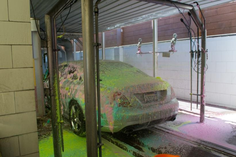 Car in multicolored car wash