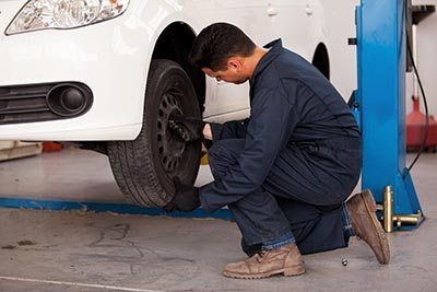 Mechanic changing tire
